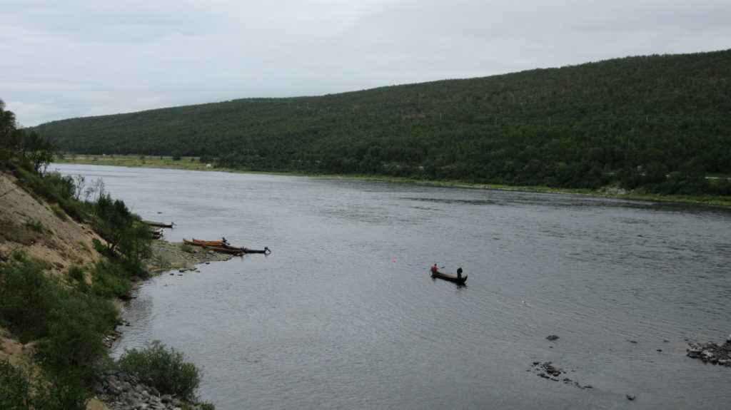 Salmon fishermen on a traditional boat on Tana river